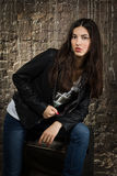 Pretty brunette woman in leather jacket Royalty Free Stock Photo