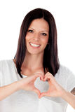 Pretty brunette woman in love making the shape of a heart with h Royalty Free Stock Images
