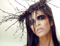 Pretty brunette woman with make up like demon Stock Images