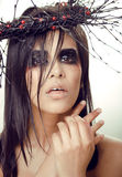 Pretty brunette woman with make up like demon Stock Photos