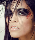 Pretty brunette woman with make up like demon Royalty Free Stock Image