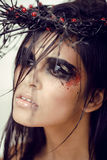 Pretty brunette woman with make up like demon Stock Photography
