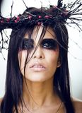 Pretty brunette woman with make up like demon at halloween, clos Royalty Free Stock Photos