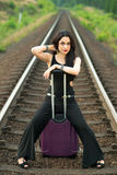 Pretty brunette woman modelling on railroad tracks Royalty Free Stock Images