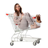 Pretty brunette woman phone speaking in empty shopping trolley Stock Photography