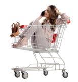 Pretty brunette woman phone speaking in empty shopping trolley Stock Photos