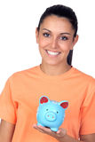 Pretty brunette woman with a piggy-bank Royalty Free Stock Photography