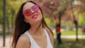 Pretty brunette woman with pink lips blowing kiss stock footage