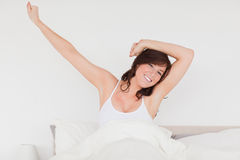 Pretty brunette woman posing while stretching Stock Photos