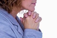Pretty brunette woman praying Stock Photo