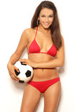 Pretty brunette woman in red bikini holding ball Stock Photos
