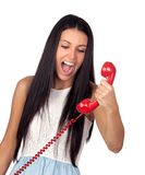 Pretty brunette woman screaming on the phone. Isolated over white Stock Photos