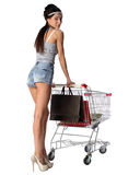Pretty brunette woman and shopping trolley with a shopping bags Stock Photo