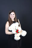 Pretty brunette woman with soft toy Royalty Free Stock Images
