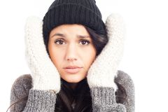 Pretty brunette woman with a woolen hat a sweater and gloves royalty free stock image