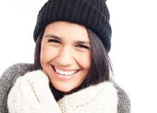 Pretty brunette woman with a woolen hat a sweater and gloves smiling and cheerful royalty free stock photography