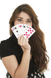 Pretty brunette young girl holding deck of cards Royalty Free Stock Photography