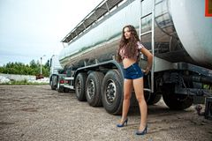 Brunette young woman and truck Stock Photo