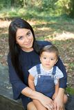 Pretty brunette young woman with long hairs with cute son child boy. Pretty brunette young women with long hairs with cute son child boy in park stock photography