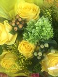 Pretty bunch of yellow roses in a floral bouquet Stock Photos