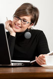Pretty business girl using a laptop  Royalty Free Stock Image