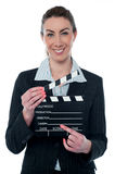 Pretty business lady with clapperboard Royalty Free Stock Photos