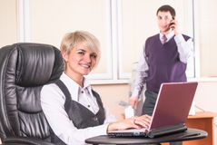 Pretty business lady with laptop Royalty Free Stock Image
