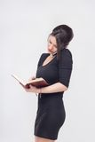 Pretty business lady standing with book Stock Photography