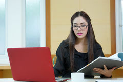 Pretty business lady working at desk Stock Image