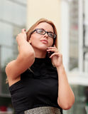 Pretty business woman with cell phone Royalty Free Stock Photos