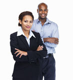 Pretty business woman with a colleague at the back Stock Images