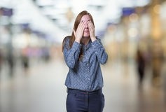 Pretty business woman covering her eyes over blur background Stock Photo