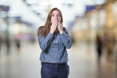 Pretty business woman covering her mouth over blur background. Pretty business woman covering her mouth over blur background Royalty Free Stock Photography