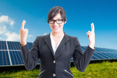 Pretty business woman doing good luck sign Stock Images