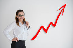 Pretty business woman drawing a graph Stock Images
