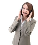 Pretty business woman in gray suit with earphones isolated on wh Stock Photo