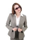 Pretty business woman in gray suit isolated on white background Stock Image