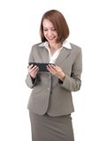 Pretty business woman in gray suit with tablet isolated on white Royalty Free Stock Images