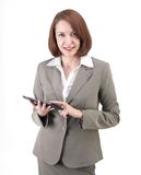 Pretty business woman in gray suit with tablet isolated on white Royalty Free Stock Photo