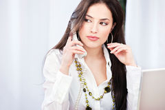 Pretty business woman having a telephone call Stock Photo