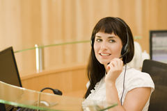 Pretty business woman with headset royalty free stock photography
