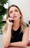 Pretty business woman on her mobile phone. Pretty caucasian business woman on her mobile phone Royalty Free Stock Photo