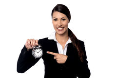 Pretty business woman holding alarm clock Royalty Free Stock Photography