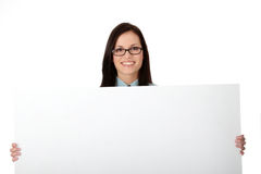 A pretty business woman holding a blank sign Royalty Free Stock Image
