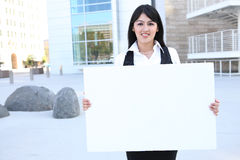 Pretty Business Woman Holding Sign stock photo