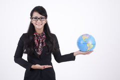 Pretty Business Woman  holds a globe. Beautiful Asian Business woman with glasses holding a globe Stock Photos