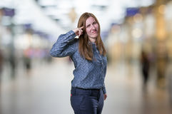 Pretty business woman making crazy gesture over blur background.  Royalty Free Stock Image