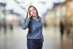 Pretty business woman making silence gesture over blur backgroun. D Royalty Free Stock Images