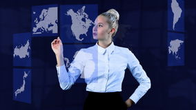 Pretty business-woman moving maps with her hand on a virtual touchscreen. Video footage of a business-woman moving geographical maps with her hand on a virtual stock video footage