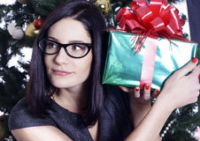 Pretty business woman near christmas tree with present Royalty Free Stock Image